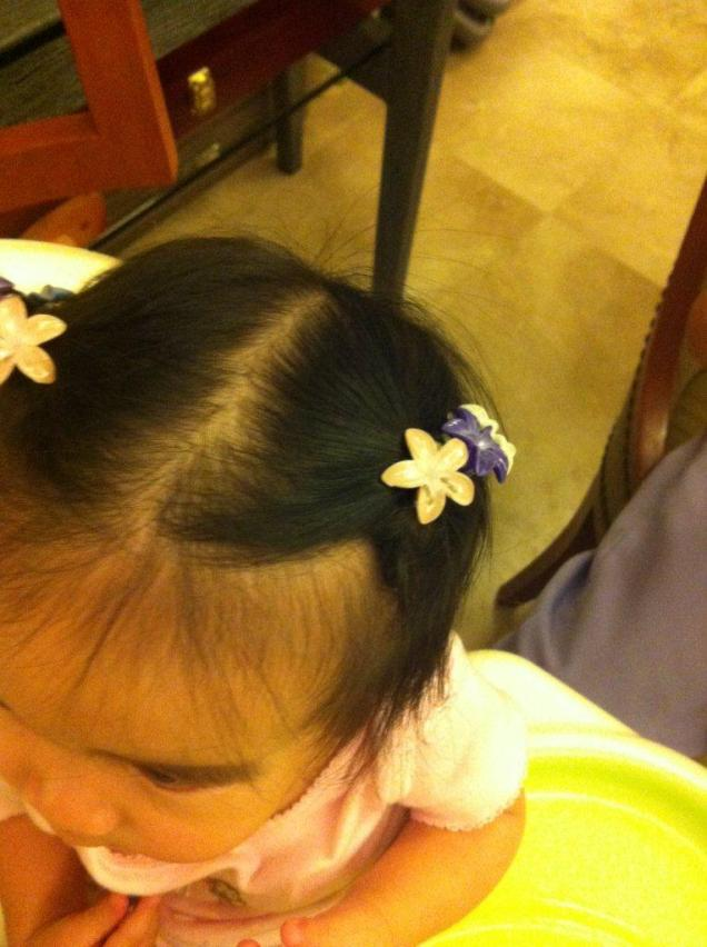 finally allowing the nanny to put clippies on my hair :)