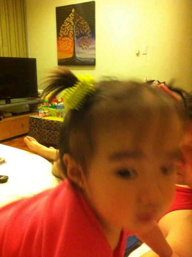 mommy being silly -- putting bristle blocks on my hair