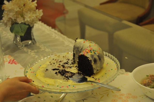 mommy baked this moist chocolate upside down cake with cream frosting